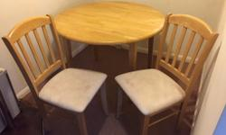 Dining Table with two chairs for sale. In good