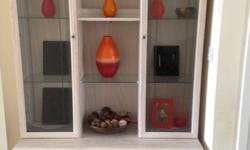 Display cabinet in very light colour and in good