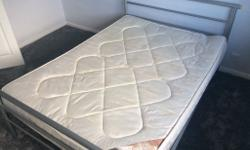 Double bed with mattress in good condition. The bed