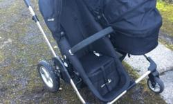 Double pram, can be used as in pictures or with both