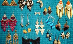 16 pairs of earrings + earring cuff. All unused and in