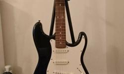 Electric guitar, stand and amp (with jack lead). Rarely