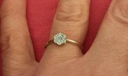 This is a lovely engagement ring that has only been