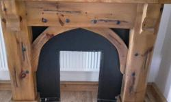 Chunky wood fire surround, fire not included. Black
