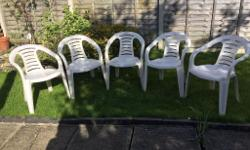 5 white stackable garden chairs , good condition,