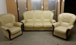 Here I have a genuine cream leather 3 piece suite with