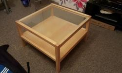 Glass top coffee table in excellent condition. No marks