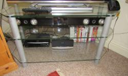 Glass TV stand for sale. Other items in picture not for