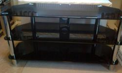 Black Glass and chrome TV Stand Very good condition Pet