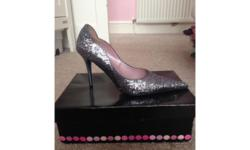 Nearly new only worn once. Nice glitzy party shoe.