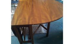 Gorgeous teak table and four chairs. Chairs need little