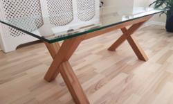 Modern glass and solid oak coffee table . In superb