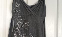 Silver and black sparkly top with tie back. Size 12.