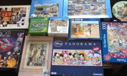 Assortment of jigsaw puzzles some 500 and others 1,000