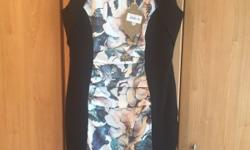 Gorgeous dress with ruched front, floral design front