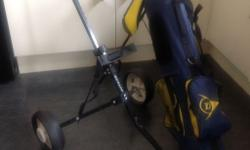 Junior Dunlop child's set of clubs with Trolly , hardly
