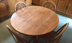 Solid oak round table (105 mm diam.) and 4 chairs. Sold