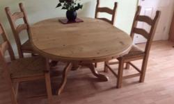 Solid extending pine dining table& 4 matching chairs in