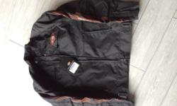 Ladies textile material waterproof jacket. Size small