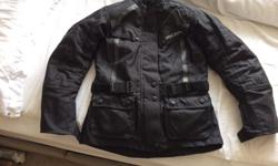 Very warm black ladies textile jacket by Richa. Size DS