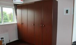 Dark veneer-finish large 5 door wardrobe. 3 sections