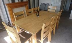 Large 8 seater dinning table and chairs. Heavy, solid