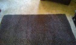 Large brown shaggy rug. Buyer is to collect from