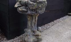 large old concrete stone planter orniment with badger &