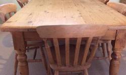 Large solid pine family dining table measuring 110cm x