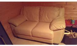 Beige leather 2 seat sofa, very little use. In very