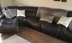 Brown leather 5 seater sofa. In good condition a few
