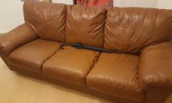 Used. Lovely One piece three seater brown leather sofa,
