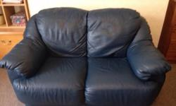 2 seater dark blue leather sofa, good condition. Smoke