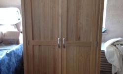 Light Oak double wardrobe, as new, excellent condition.