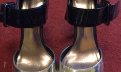 Size 4 limited collection black heels with silver over