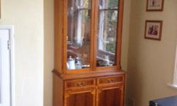 Mahogany Display Cabinet. It has 2 drawers and a shelf