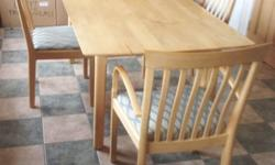 Lovely solid maple table and chairs, two of which are