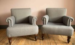 A pair of classically shaped, deep modern armchairs in