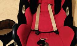 Red and black maxi cosi car seat. Suitable from birth.