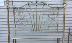 Antique metal finish double headboard and glass topped