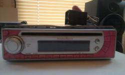 Pink car stereo in good condition. A few light scuffs