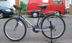 MOUNTAIN BICYCLE, 22 INCH FRAME ,21 GEARS , MUDGUARDS,