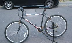 MOUNTAIN BICYCLE , 20 INCH FRAME , 21 GEARS , GOOD