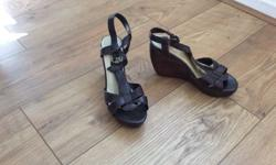 Brand new and never worn. Brown wedges, very stylish