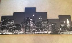 Night time skyline of New York captured on 6 canvases.