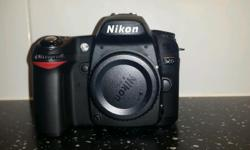 Nikon D 80 camera body with strap. Excellent condition.