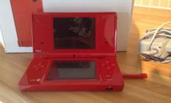 Red DSi with camera, hardly used. Really is like new.