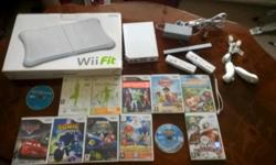 Nintendo wii console including wii fit board and lots