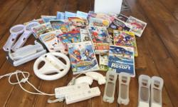 Nintendo WII, with 23 WII games plus two WII remotes