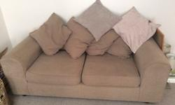 Two and three seater fabric sofas. Loose cushions at